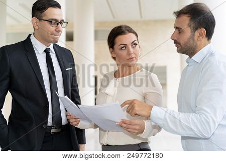 Business People Discussing Papers With Strict Leader. Nervous Business Partners Talking About Inform