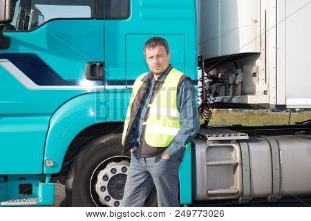 Logistics Man Driver Front Cabin Of Big Modern Long-haul Truck