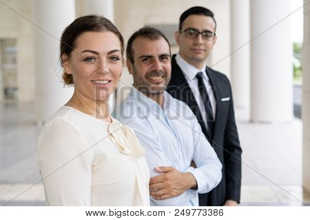 Corporate Portrait Of Pretty Smiling Business Lady With Coworkers. Pretty Smiling Head Of Business C