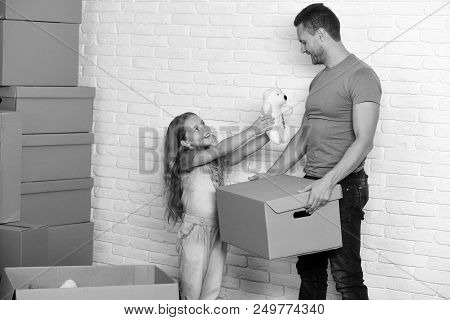 New Home And Family Concept. Kid And Guy Move In Or Move Out. Daughter And Father Hold Box, White Te