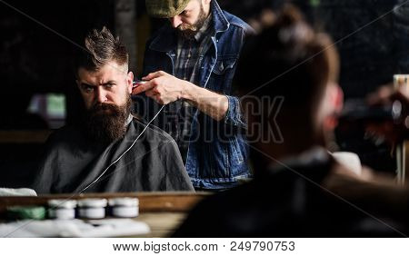Hipster Client Getting Haircut. Barber With Clipper Trimming Hair On Nape Of Client. Hipster Hairsty
