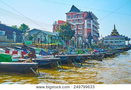 Nyaungshwe, Myanmar - February 19, 2018: The Canal In Tourist Village, Full Of Moored Canoe Boats, M