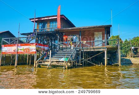 Nyaungshwe, Myanmar - February 19, 2018: The Stilt House On Canal Serves As The Rental Boat Point Of