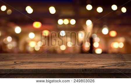 Wooden Table For Product Display On Abstract Restaurant Lights Background