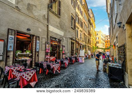 Rome, Italy - September 19 2016: Colorful Restaurant With Sidewalk Cafe In A Back Alley In Rome Ital