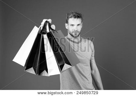 Shopping Or Sale And Cyber Monday. Man With Shopping Bags On Violet Background. Macho With Colorful