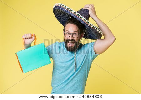 Mexican Shopping. Man Smiling Face In Sombrero Hat Shopping Yellow Background. Guy With Beard Looks