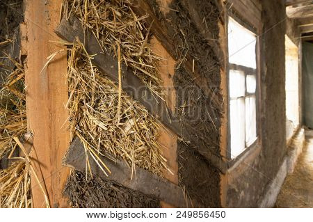 The wall of the adobe house from the clay and the straw poster