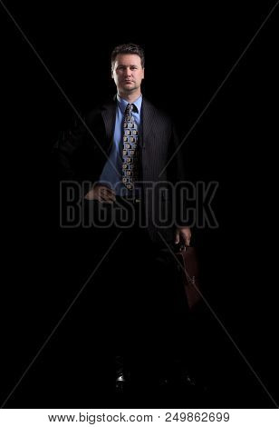 in full growth. confident businessman with briefcase