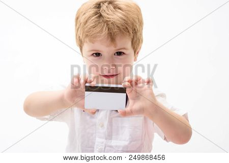 Boy In White Shirt Showing Blank Credit Card. Cash. Credit Card. Business-card. Plastic Bank Card Wi