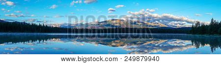 Panorama Of Morning Sun And Low Clouds Over The Rocky Mountains At Annette Lake In Jasper National P