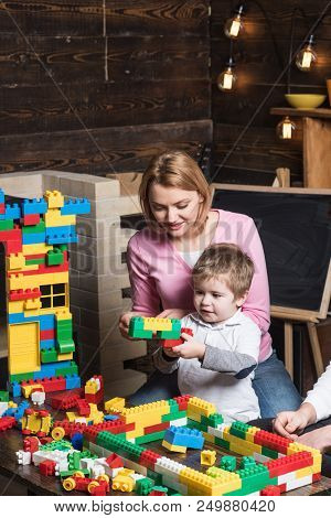 Mother Concept. Mother And Son Play Toy Bricks. Mother And Child Building Structure Model With Block