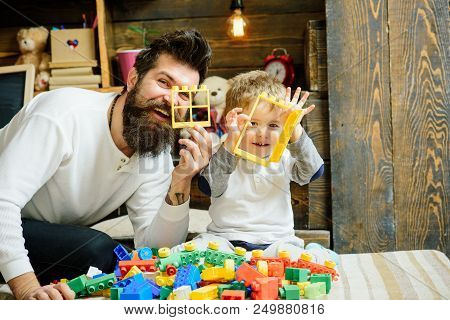 Friend Concept. Father And Child Play With Construction Toys, Friends. Father And Son Make Good Frie