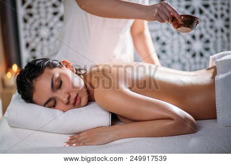 Massage Gel For Relaxation. Masseur Applying Massage Oil On The Body. Key To A Good Massage