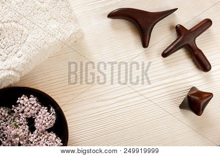 Spa And Massage Concept. Special Carved Wooden Massage Sticks, Cottony Terry Towel, Bowl With Lilac