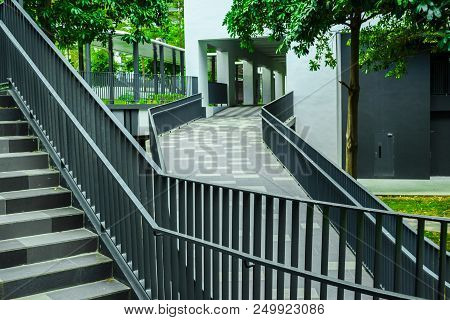 Empty Stair And Ramp Construction In Modern City. Cityscape In Singapore. Hightech And Green.
