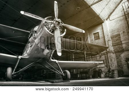 Historical Aircraft In A Hangar Into Sunlight