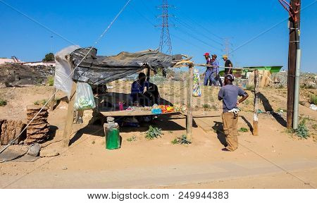 Johannesburg, South Africa, September 11, 2011, Small Informal Hawker Selling Items On Street In Urb