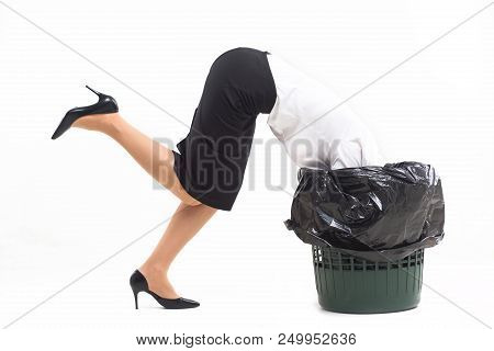 Woman getting stuck in trash can with her head. Crazy woman wearing white blouse black skirt and black heels got stuck in bucket for trash. poster