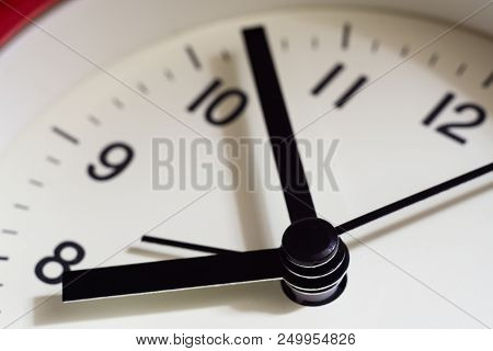 Close Up Part Of Red Alarm Clock Face, Time Close Up.