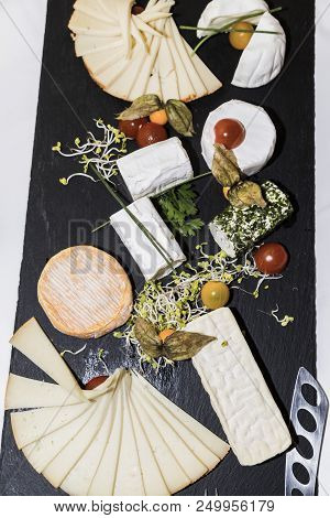 Cheese Appetizing Set: Different Types Of Cheese For Wine On Rustic Wooden Dark Board. Top View