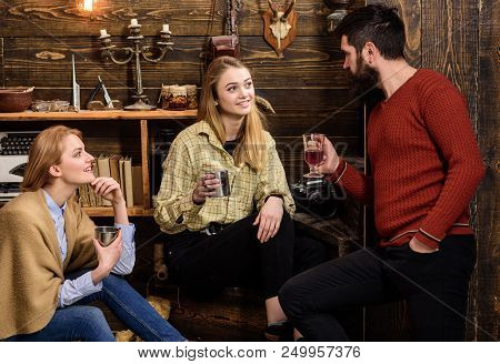 Family Enjoy Conversation In Gamekeepers House. Sincere Conversation Concept. Friends, Family Spend