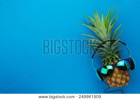 Flat Lay Objects Sign Of Travel Summer Holiday Background Concept.table Top View Of Pineapple Lighte