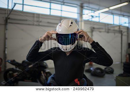 Motorbike Driver Putiing On His Helmet Before The Race