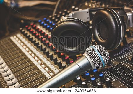 Close Up Instruments Music Background Concept.single Microphone With Headphones On Sound Mixer Board