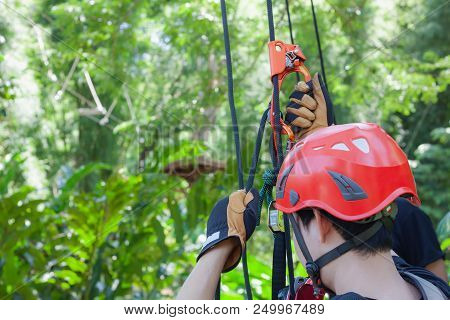 Work Safe Background Concept.soft Focus Close Up Young Man Asian Use Safety Harness With Equipment F