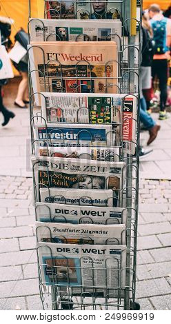Paris, France - Oct 28, 2017: International Newspapers Featuring Election Of Angela Merkel In German