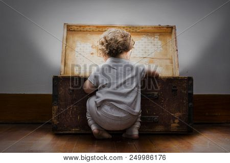 Toddler Looking Into Mysterious Brightly Lit Treasure Chest Discovering New Things