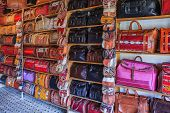 Moroccan leather goods and bags with metal ornaments at a souk or market by the tannery in Fes, Morocco. poster