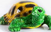 Ceramic figurine of small turtle. Close-up view poster