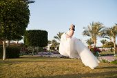 Bride concept. Bride hover in air. Bride in white wedding dress. Bride celebrate her special day. What a lovely dress. poster