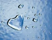 Abstract water heart and drops on textured surface. Valentine concept poster