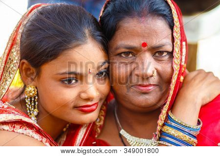 SARNATH, INDIA, JANUARY 21, 2019 : Portrait a mother and daugther Indian gypsy dancers in the street of Sarnath.