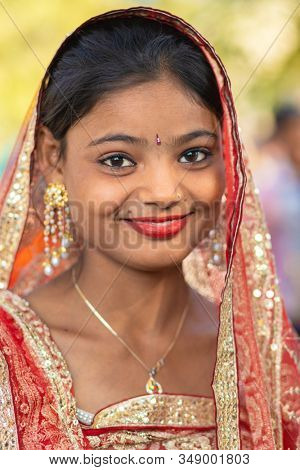 SARNATH, INDIA, JANUARY 21, 2019 : Portrait of an Indian girl gypsy dancer in the street of Sarnath.