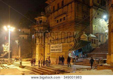 VARANASI, INDIA, JANUARY 17, 2019 : Night scenery of the famous Varanasi ghats and Ganges river
