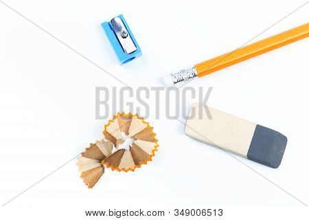 A Sharpener, Eraser And Yellow Pencil Isolated On A White  Background - Image