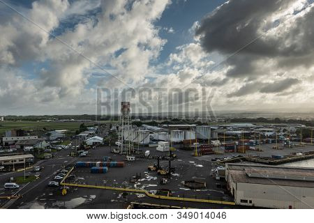 Hilo, Hawaii, Usa. - January 14, 2020: Long Evening Shot Over Most Of Local Port With Tanks, Stacked