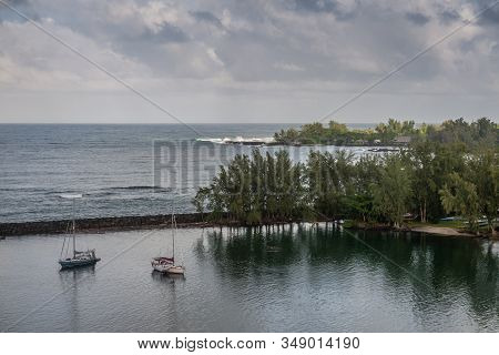 Hilo, Hawaii, Usa. - January 14, 2020: Ocean Port Separated By Breakwater From Gray-blue Ocean Under