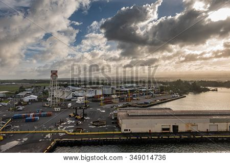 Hilo, Hawaii, Usa. - January 14, 2020: Wide Shot Over Most Of Local Port With Tanks, Stacked Shippin