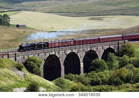 Dent Head, England - July 24:  Preserved Steam Locomotive 45407 Heads The Waverley Over Dent Head Vi