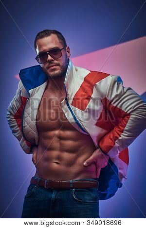 Muscular Man Is Demonstraiting His Perfect Abs Wearing Jacket And Sunglasses.