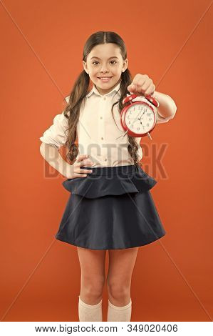 Start Lesson. Time To Go To School. School Time. Happy Girl Hold Alarm Clock Counting For Lunch Time
