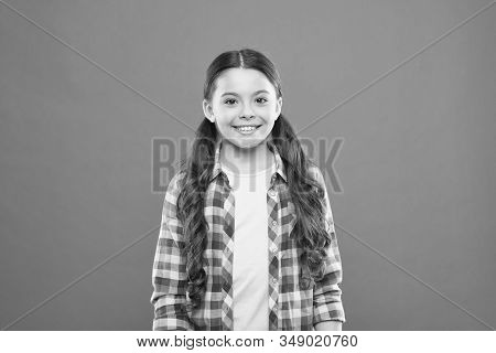 Upbringing Versatile Personality. Wellbeing And Health. Childhood Concept. Girl Child Stand Orange B