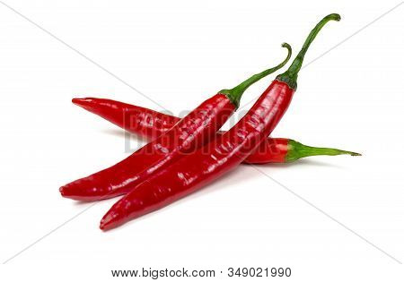 Fresh Red Hot Chilli Pepper Isolated On A White Background.