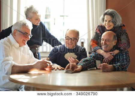 group of seniors play cards