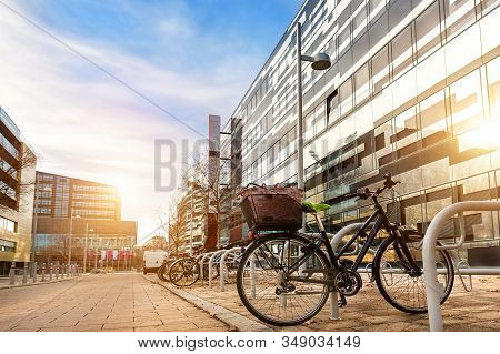Bike Parked Near Modern Apartment Residential Buiding Or College Campus At Downtown Of European City